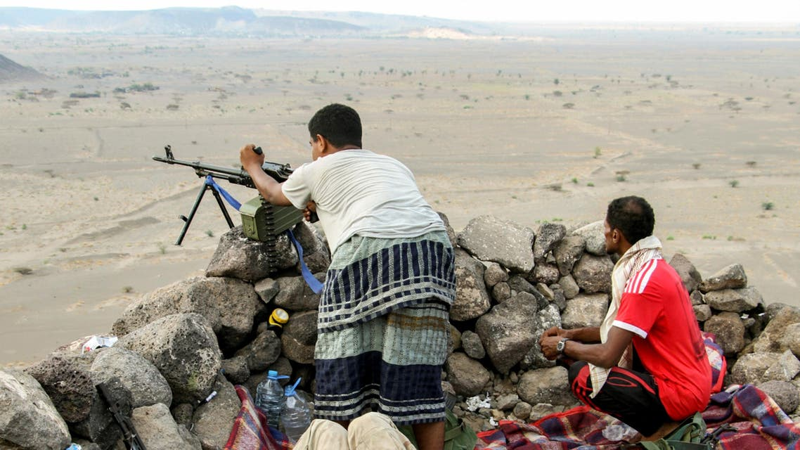 Yemeni fighters loyal to the Saudi-backed Yemeni president hold a hill-top position northwest of the central city of Taiz, on April 20, 2017. SALEH AL-OBEIDI / AFP