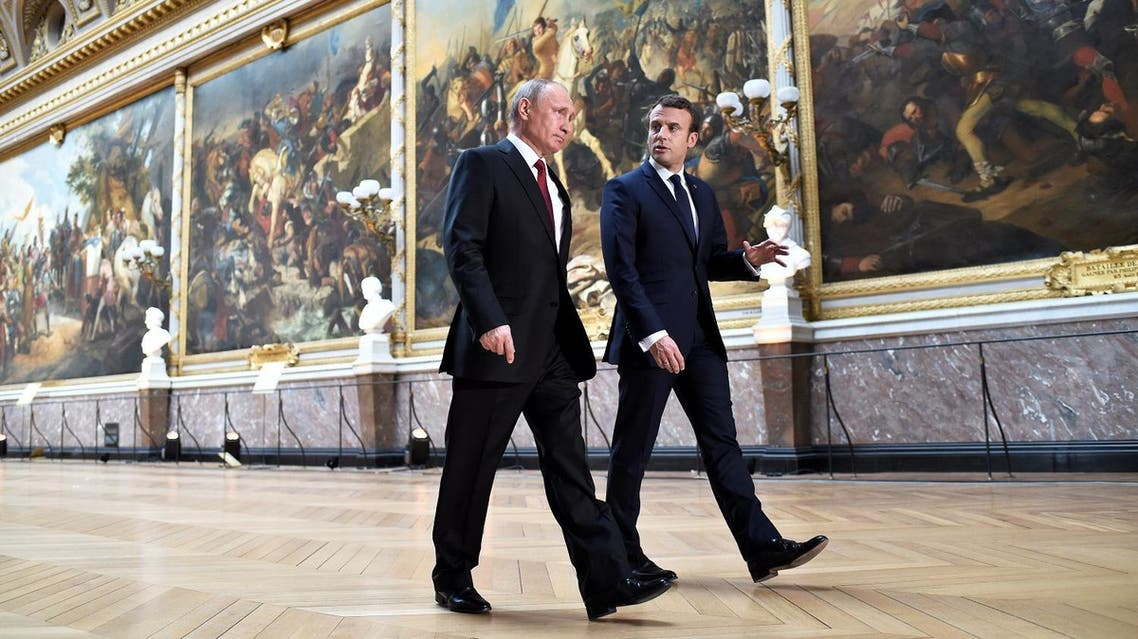 Emmanuel Macron with Vladimir Putin in the Gallery of Battles as they arrive for a joint press conference following their meeting at the Versailles Palace, near Paris, on May 29, 2017. (AFP)