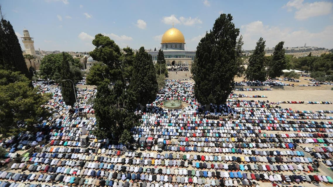 The Dome of the Rock is seen in the back ground as Palestinians pray on the first Friday of the holy fasting month of Ramadan. (Reuters)