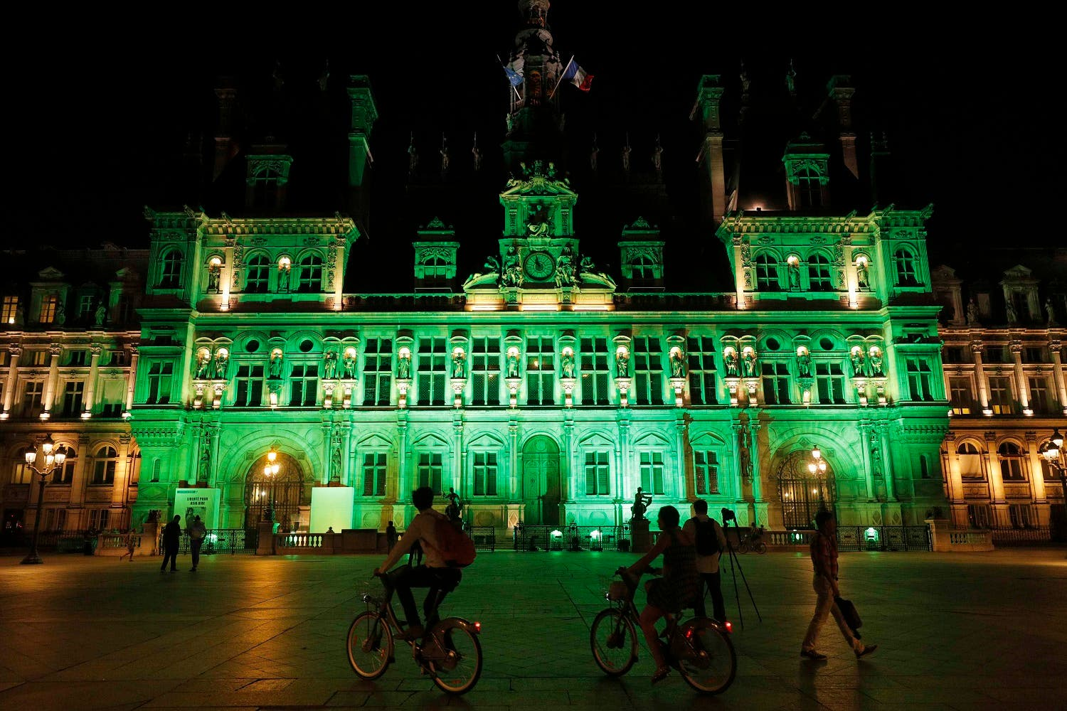 Green lights are projected onto the facade of the Hotel de Ville in Paris, France, after US President Donald Trump announced his decision to withdraw from the Paris Climate Agreement. (Reuters)