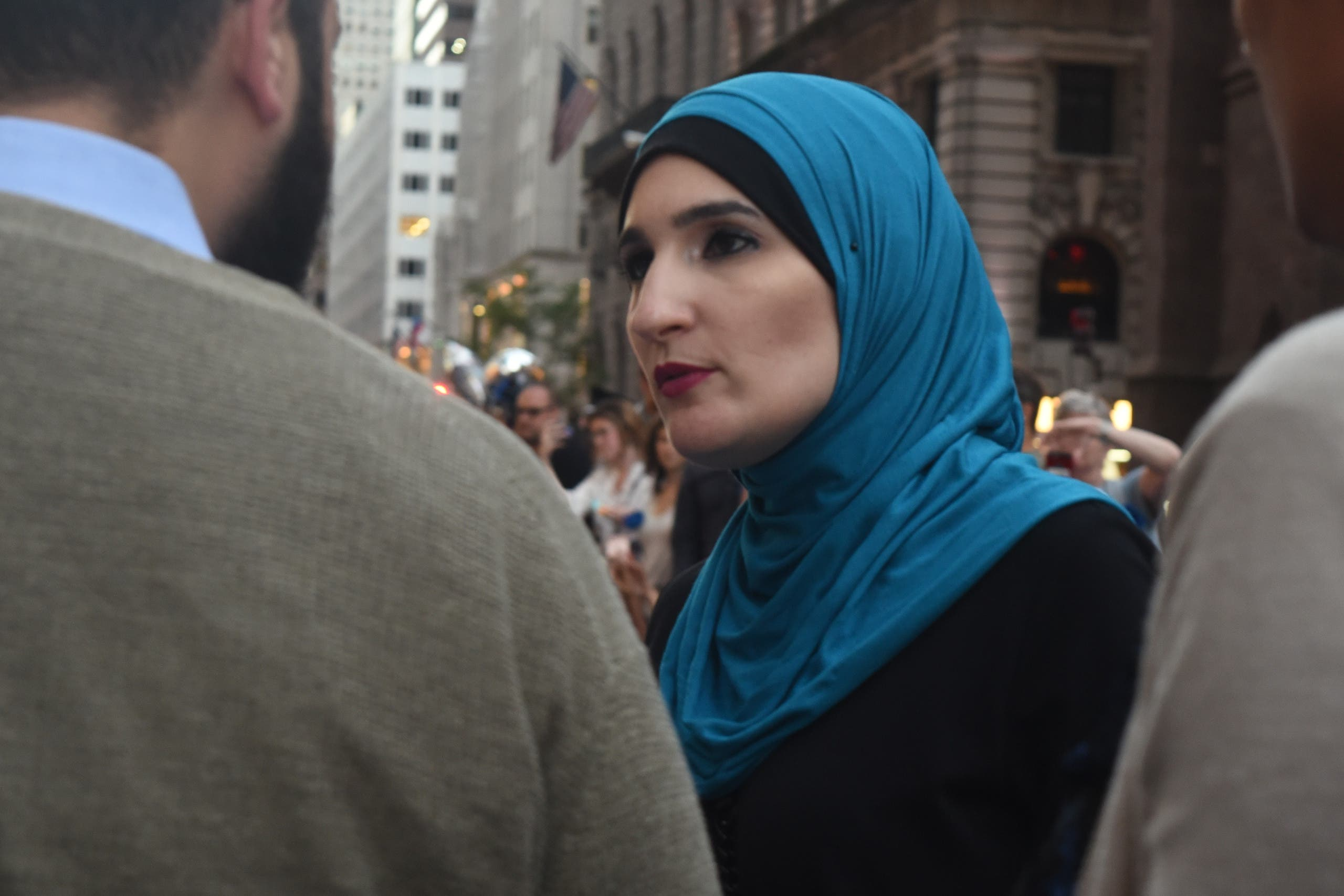 Sarsour3: Sarsour speaks to the press before iftar begins.