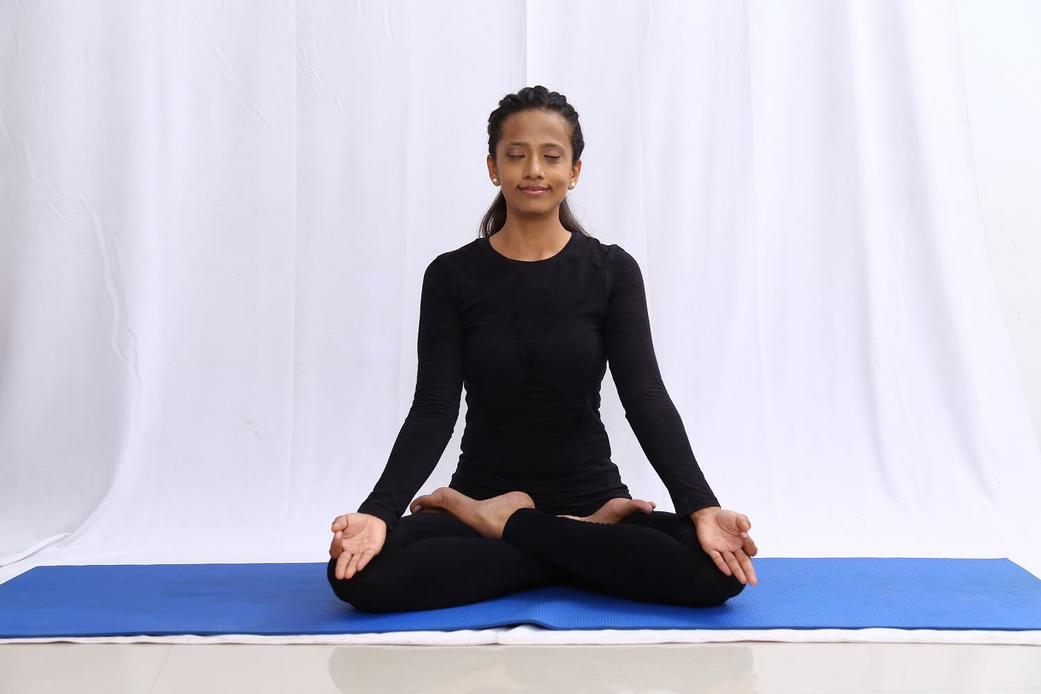 Young Indian girl in a yoga pose. (Supplied)
