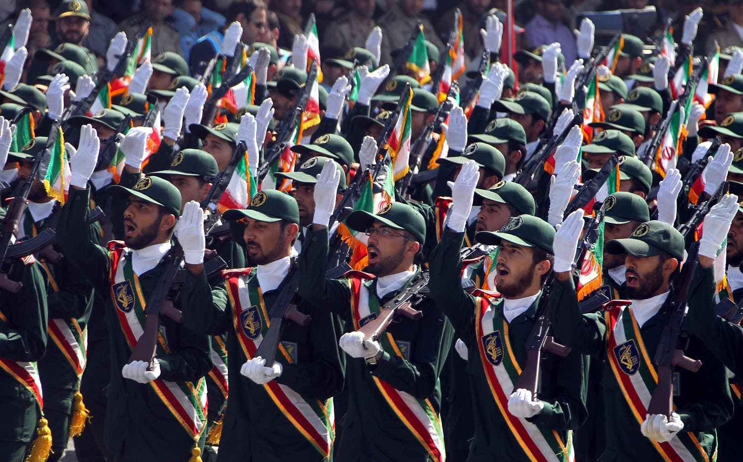 Members of IRGC participating in a march past during an annual military parade in Tehran, on September 22, 2013. (AFP)