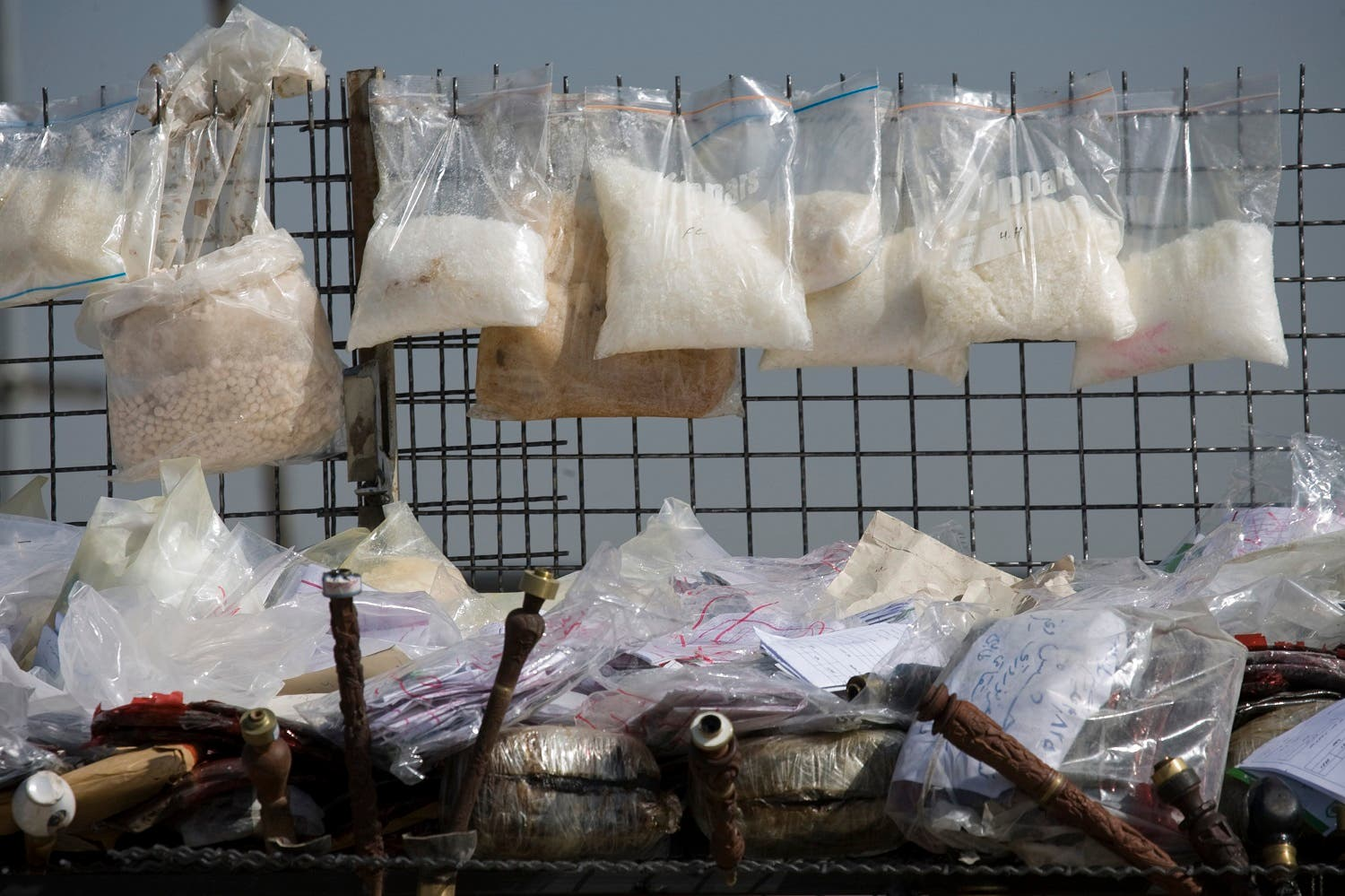 Drugs are prepared for burning during a ceremony in southern Tehran, March 9, 2009. (Reuters)