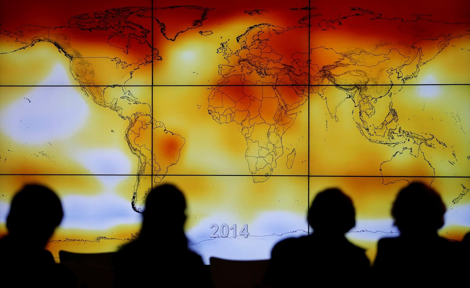 Participants are seen in silhouette as they look at a screen showing a world map with climate anomalies during the World Climate Change Conference 2015 (COP21) in Paris. (File photo: Reuters)