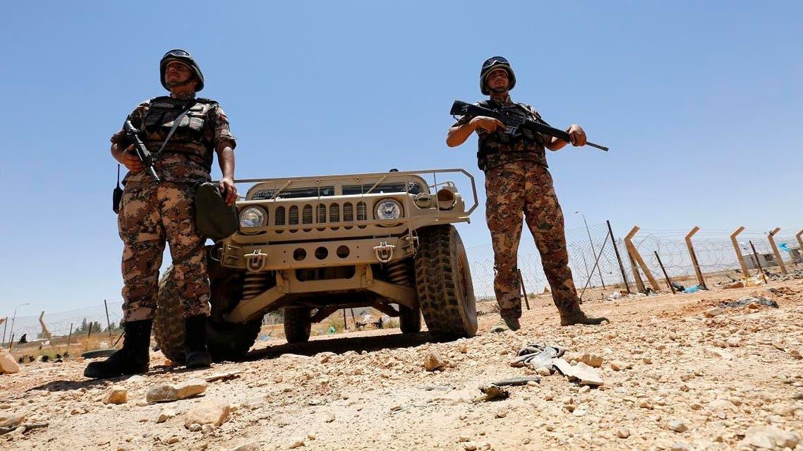 Jordanian soldiers stand guard near the Jordanian Karameh border crossing at the Jordanian-Iraqi border, near Ruweished city, June 25, 2014. (Reuters)