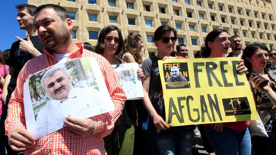 Journalists attend a rally Tbilisi, Georgia, Wednesday, May 31, 2017, to support an Azerbaijani journalist Afgan Mukhtarli, who was abducted in Tbilisi on May 29 and now is in detention in the Azerbaijan capital Baku. (AP)