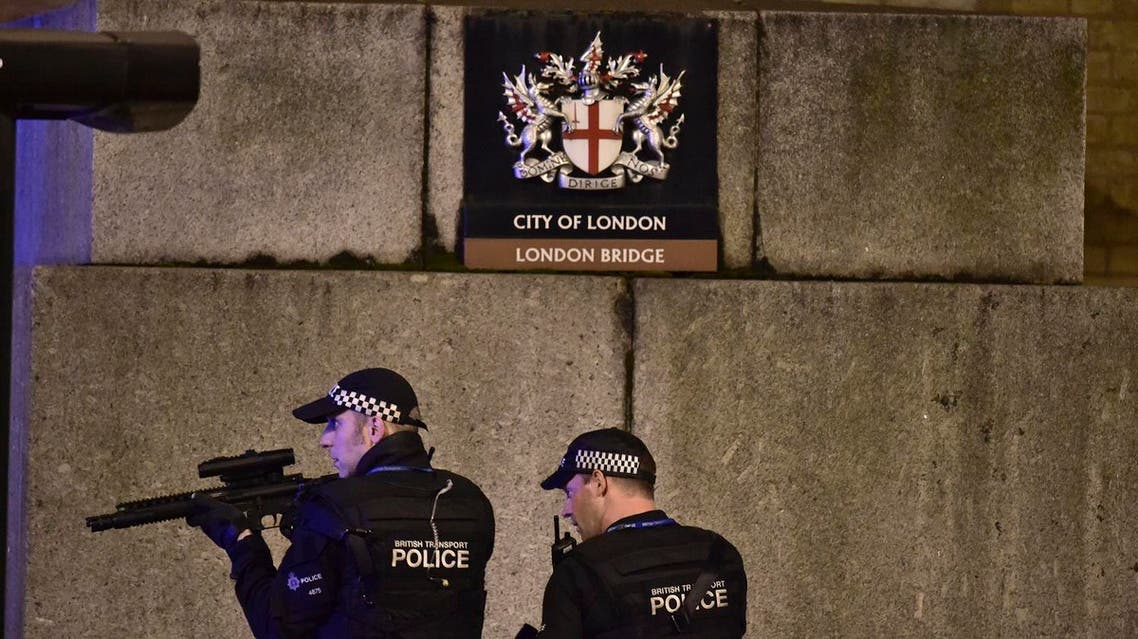 An armed Police officer looks through his weapon on London Bridge in London, Saturday, June 3, 2017. (AP)
