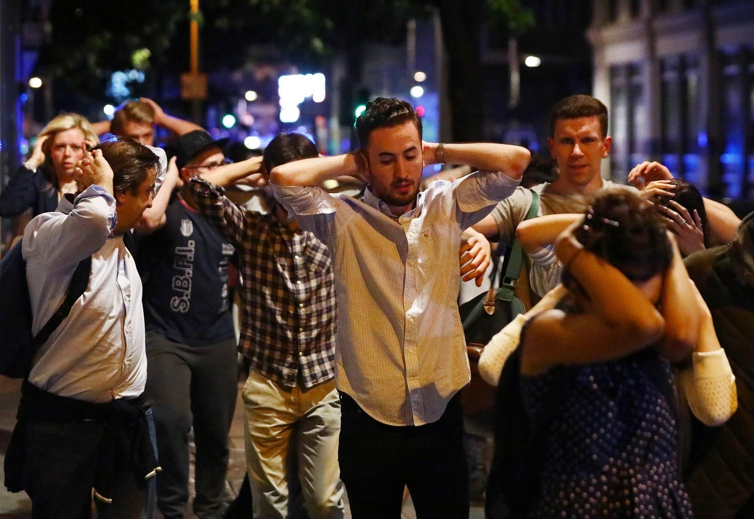 People leave the area with their hands up after an incident near London Bridge in London, Britain June 4, 2017. reuters