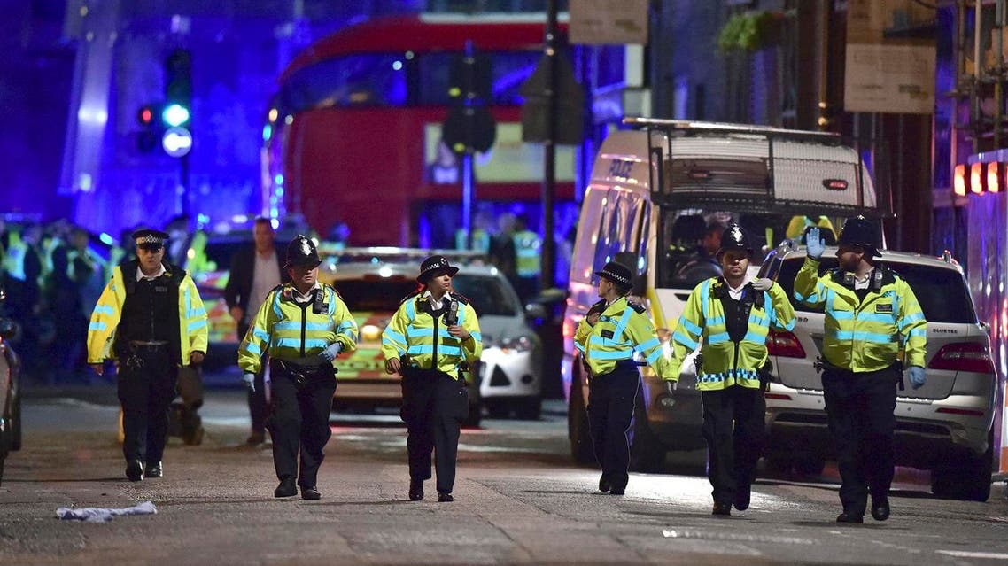 Police officers on Borough High Street as police are dealing with an incident on London Bridge in London, Saturday, June 3, 2017. (AP)