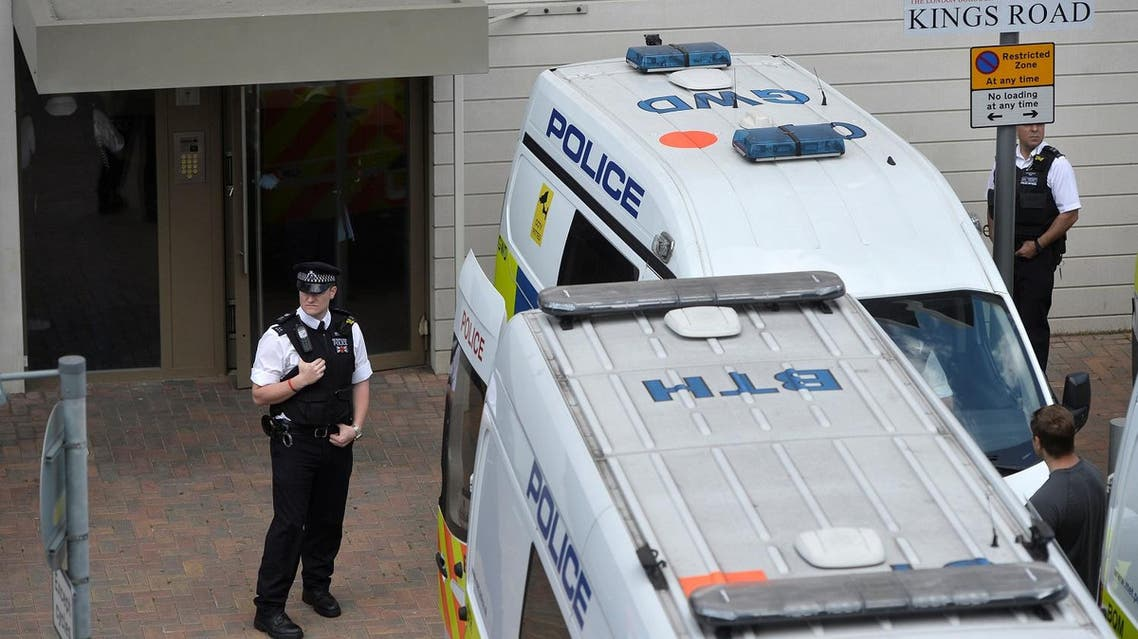 Officers and vehicles stand outside a block of flats that was raided by police in Barking, east London, Britain, on June 4, 2017. (Reuters)