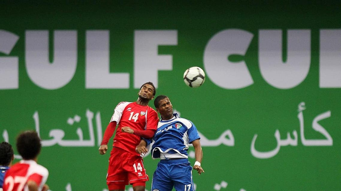 UAE's Abdulaziz Mohammed (L) jumps to head the ball with Kuwait's Ahmed Nasser during the under-23 Gulf Cup final football match in the Qatari capital Doha on August 7, 2010. (AFP)