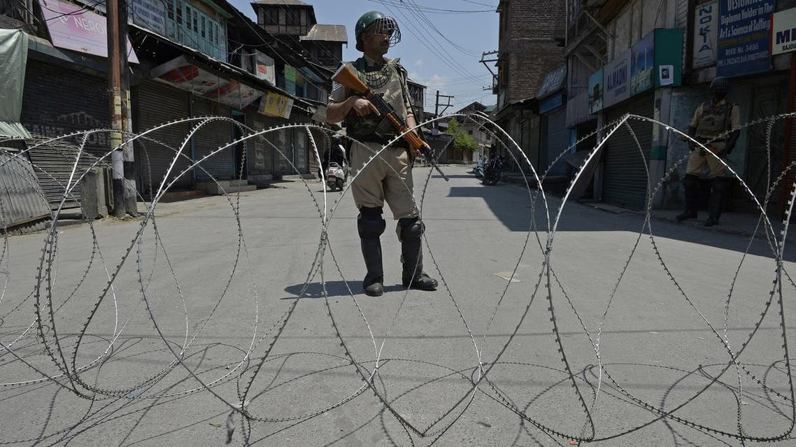 An Indian paramilitary soldier stands guard during a curfew in downtown Srinagar on May 30, 2017. (AFP)