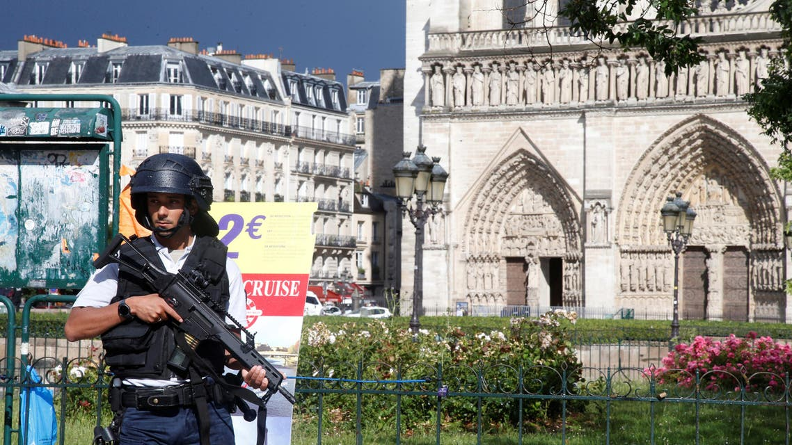 French police stand at the scene of a shooting incident near the Notre Dame Cathedral in Paris, France, June 6, 2017. (Reuters)