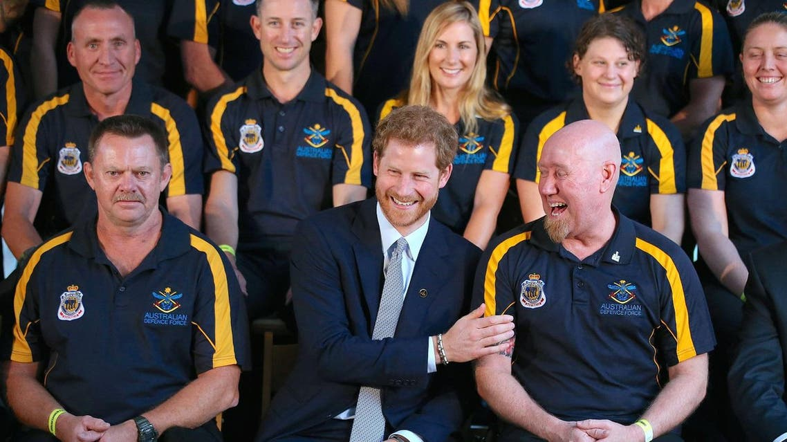 Britain's Prince Harry laughs with Jeff Wright (R) and other members of the Australian Defence Force at a promotional event for the 2018 Invictus Games in Sydney, Australia, June 7, 2017. (Reuters)
