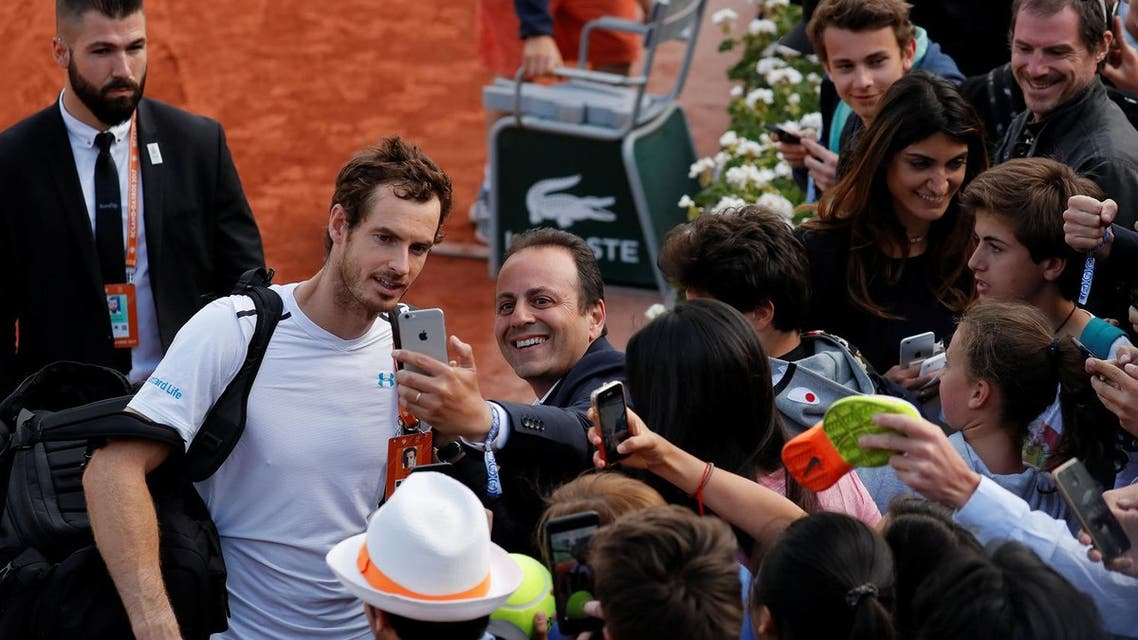 Great Britain's Andy Murray celebrates with fans after winning his quarter final match against Japan's Kei Nishikori. (Reuters)