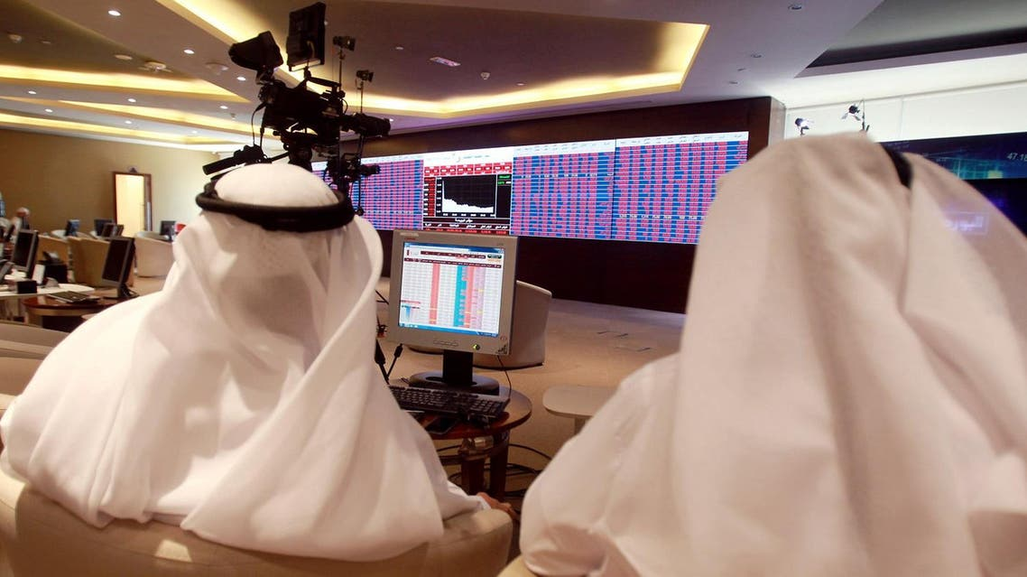 Traders monitor screens displaying stock information at Qatar Stock Exchange in Doha, Qatar, on June 5, 2017. (Reuters)