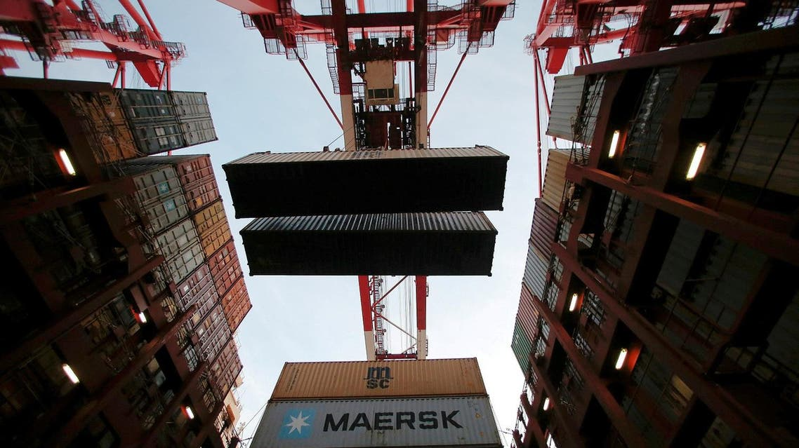 Containers are seen unloaded from the Maersk's Triple-E giant container ship at the Yangshan Deep Water Port in Shanghai, China, September 24, 2016. (Reuters)