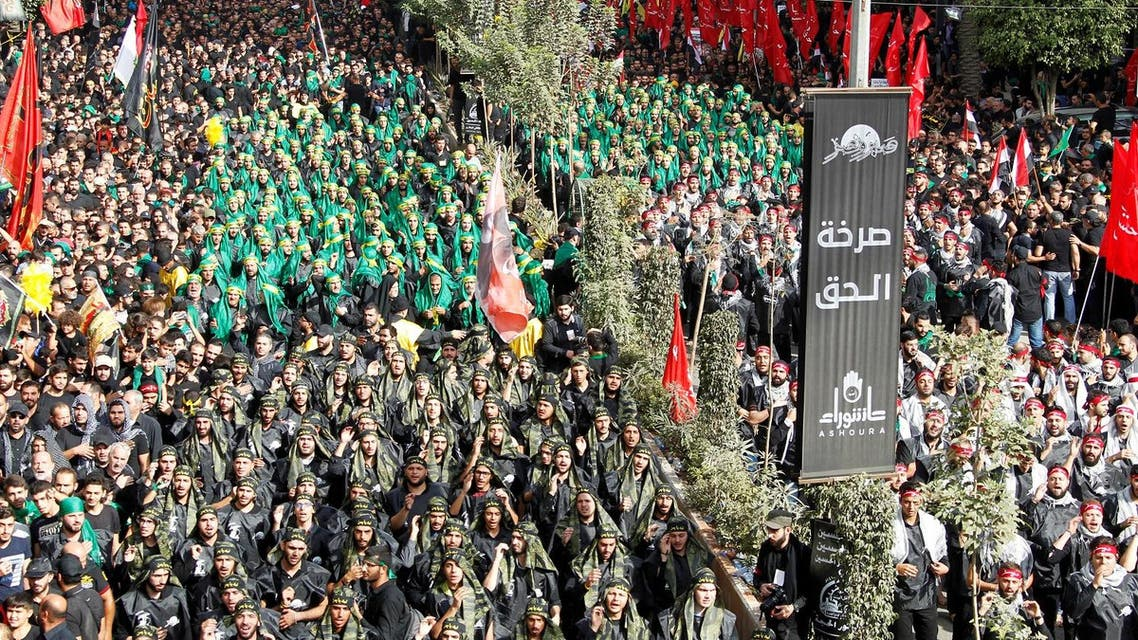 Lebanese Hezbollah supporters gesture during a religious procession to mark Ashura in Beirut's southern suburbs on October 12, 2016. (Reuters)