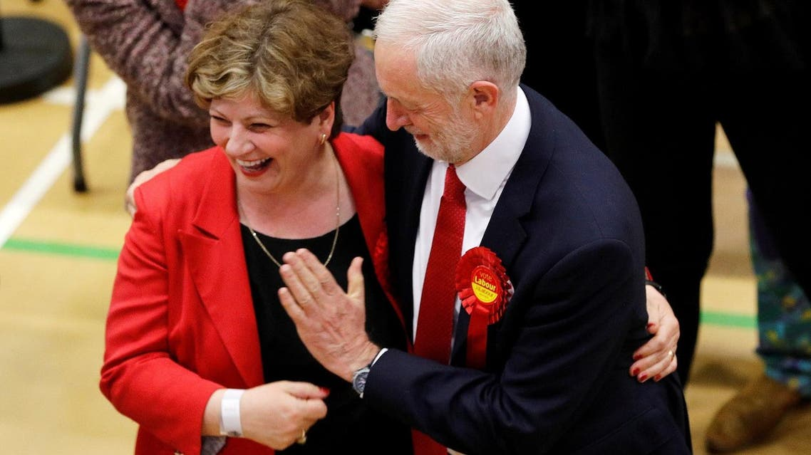 Jeremy Corbyn, leader of Britain's Labour Party, tries to exchange a high five with Shadow Foreign Secretary Emily Thornberry at the general election counting center. (Reuters)