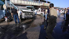 Woman suicide bomber kills at least 30 in Iraqi market