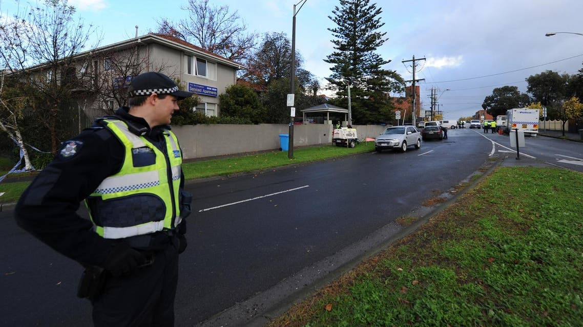A policeman keeps watch at the scene of a shootout in the Melbourne bayside suburb of Brighton on June 6, 2017. (AFP)