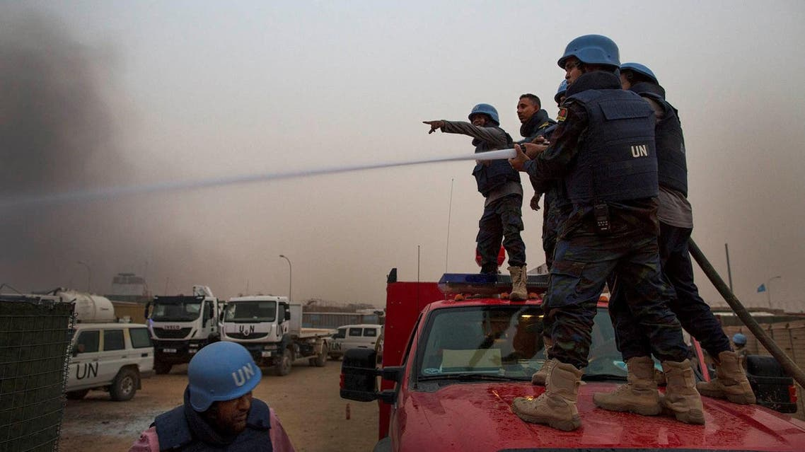 United Nations peacekeepers at the MINUSMA base fight fires after a mortar attack in Kidal, Mali, on June 8, 2017. (Reuters)