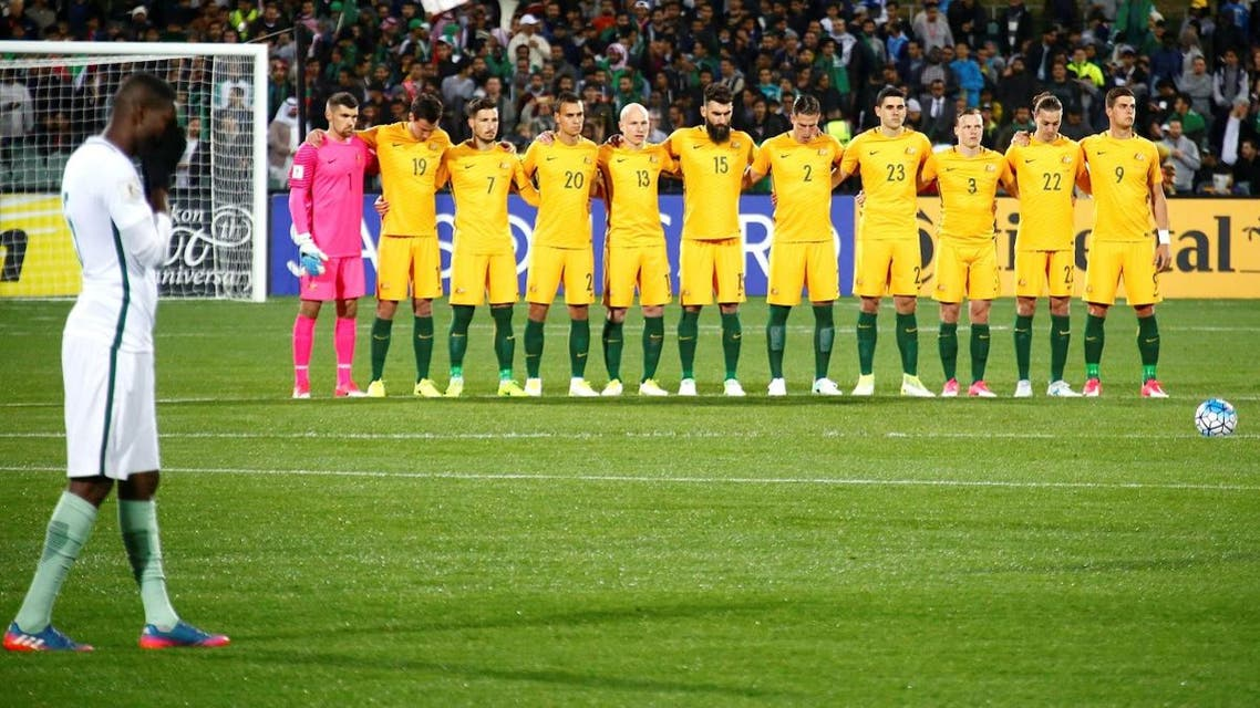 The Australian team stand together as they observe a minute's silence for victims of the London attacks, in which two Australians died. (Reuters)