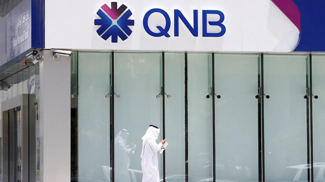 Man walks past a branch of Qatar National Bank in Riyadh. (Reuters)