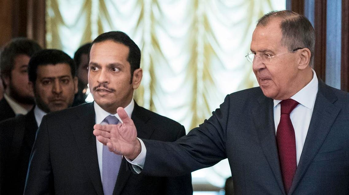 Russian Foreign Minister Sergey Lavrov, right, welcomes Qatari Foreign Minister Sheikh Mohammed bin Abdulrahman bin Jassim Al-Thani during their meeting in Moscow. (AP)