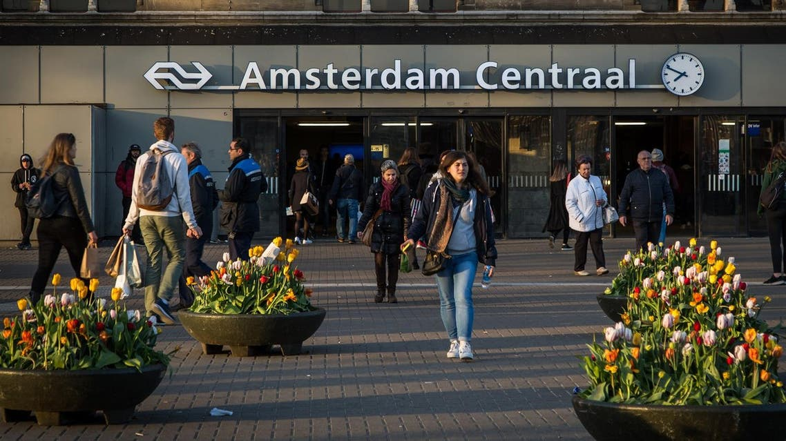 View of the entrance of the Central Train Station of Amsterdam at sunset in April 11, 2017.  (AFP)