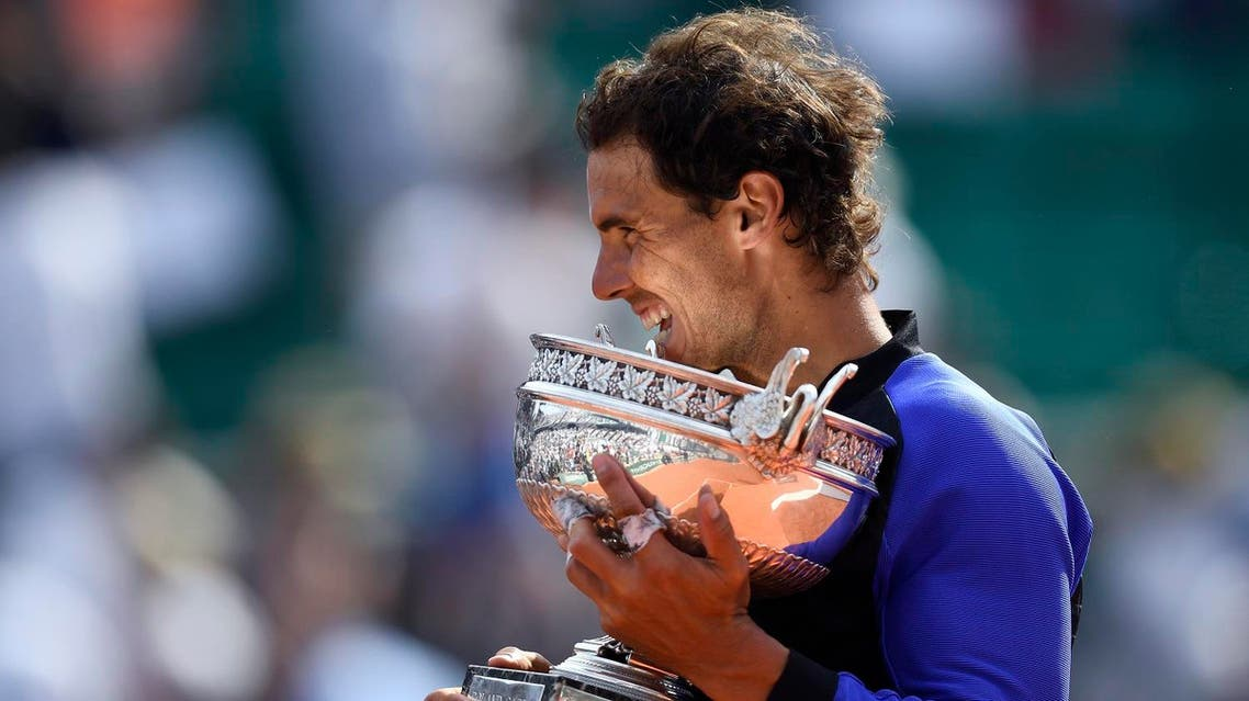 Spain's Rafael Nadal poses with the trophy after winning the men's final tennis match against Switzerland's Stanislas Wawrinka at the Roland Garros 2017 French Open on June 11, 2017 in Paris. (AFP)