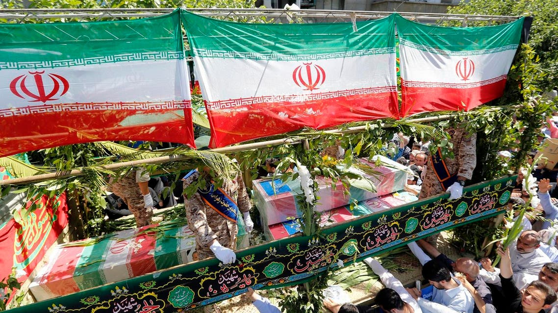 Iranians march during the funeral of the victims of the attacks on Tehran's parliament complex and the shrine of Ayatollah Khomeini, in Tehran on June 9, 2017. (AFP)
