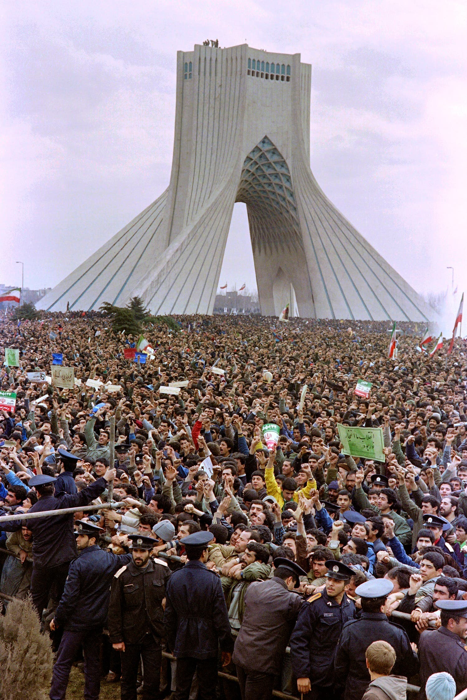 This February 17, 1989 Tehran photo shows Iranian people gathered in front of the Azadi Tower for the 10th anniversary of the plan, marking the Islamic revolution. (AFP)