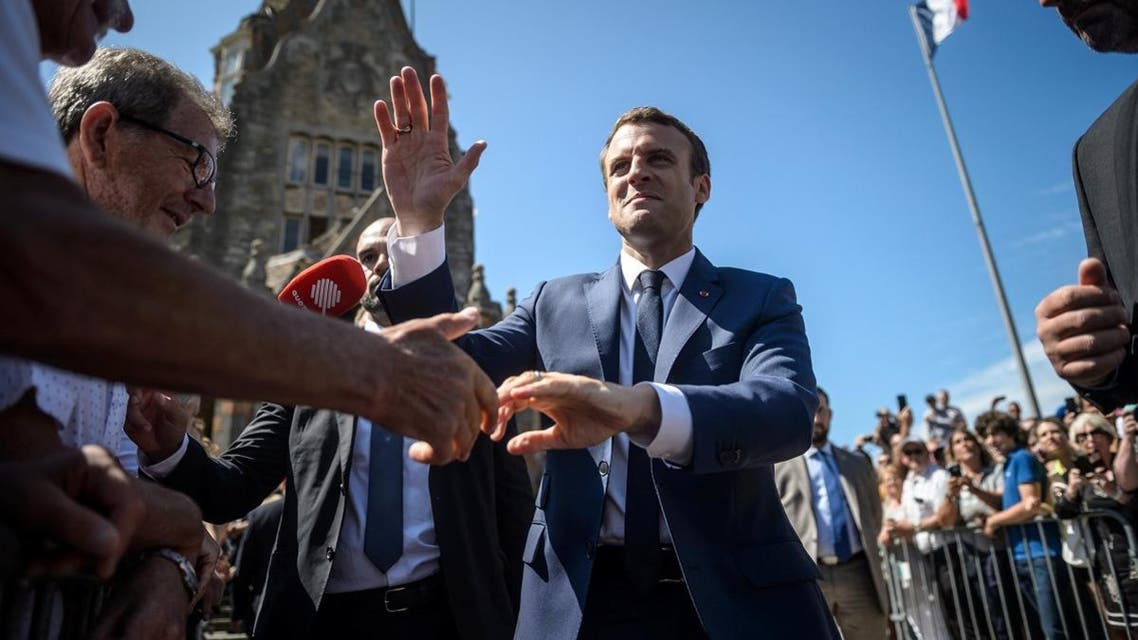 French President Emmanuel Macron leaves polling station after voting in parliamentary elections in Le Touquet. (Reuters)