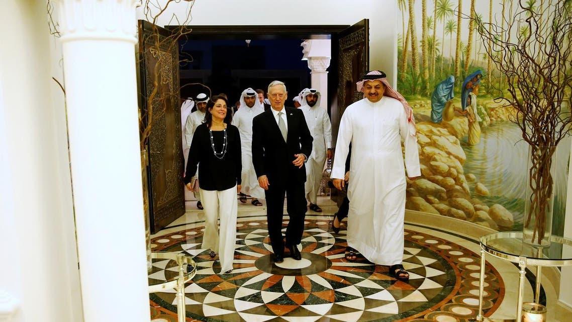 Qatar's Minister of Defence Khalid bin Mohammad Al-Attiyah (R) welcomes US Defence Secretary James Mattis (C) and US Ambassador to Qatar Dana Shell Smith (L). (Reuters)