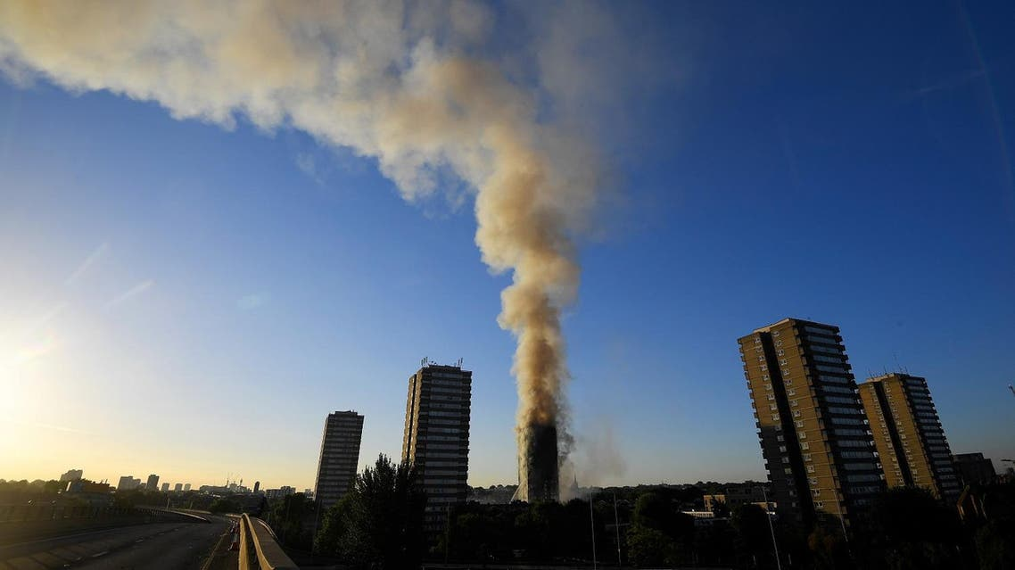 The A40 road is seen closed as flames and smoke billow as firefighters deal with a serious fire in a tower block at Latimer Road in West London, Britain June 14, 2017. (Reuters)