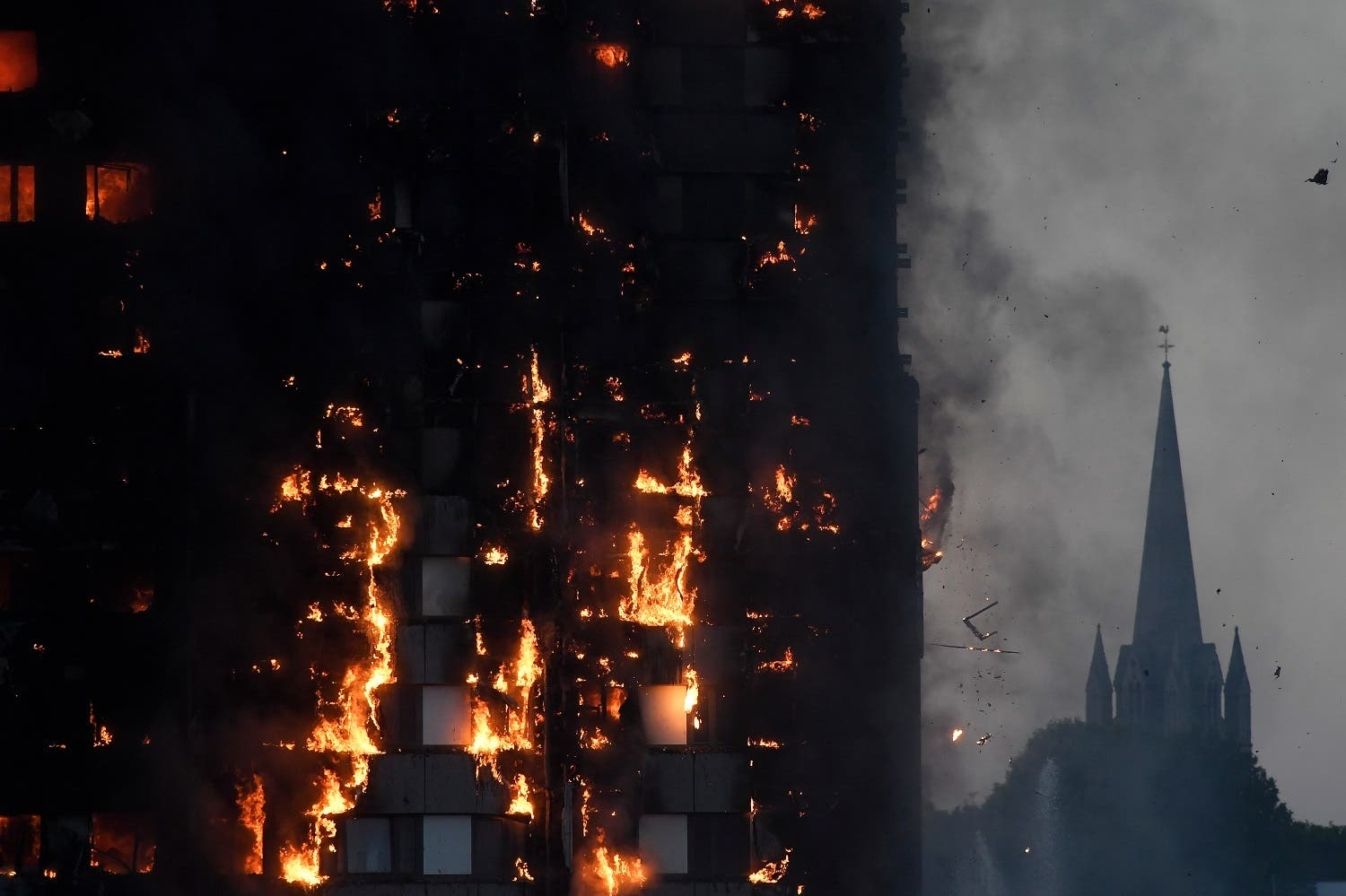 Flames and smoke billow as firefighters deal with a serious fire in a tower block at Latimer Road in West London on June 14, 2017. (Reuters)