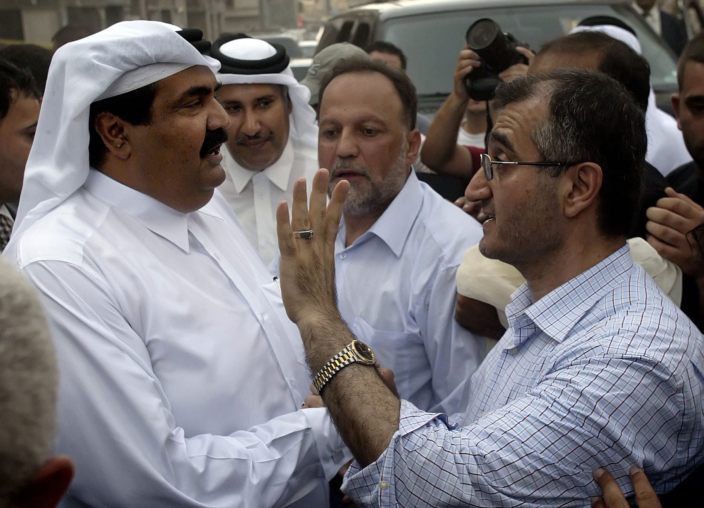 Hajj Hussein al-Khalil (R), political advisor of the Secretary General of pro-Iranian Hezbollah Hassan Nasrallah, gestures as he greet Emir of Qatar Sheikh Hamad bin Khalifa al-Thani, during his visit to the devastated Beirut southern suburb to inspect the neighborhood, 21 August 2006 that was almost destroyed in 34 days of bloody war between Israel and Hezbollah militants
