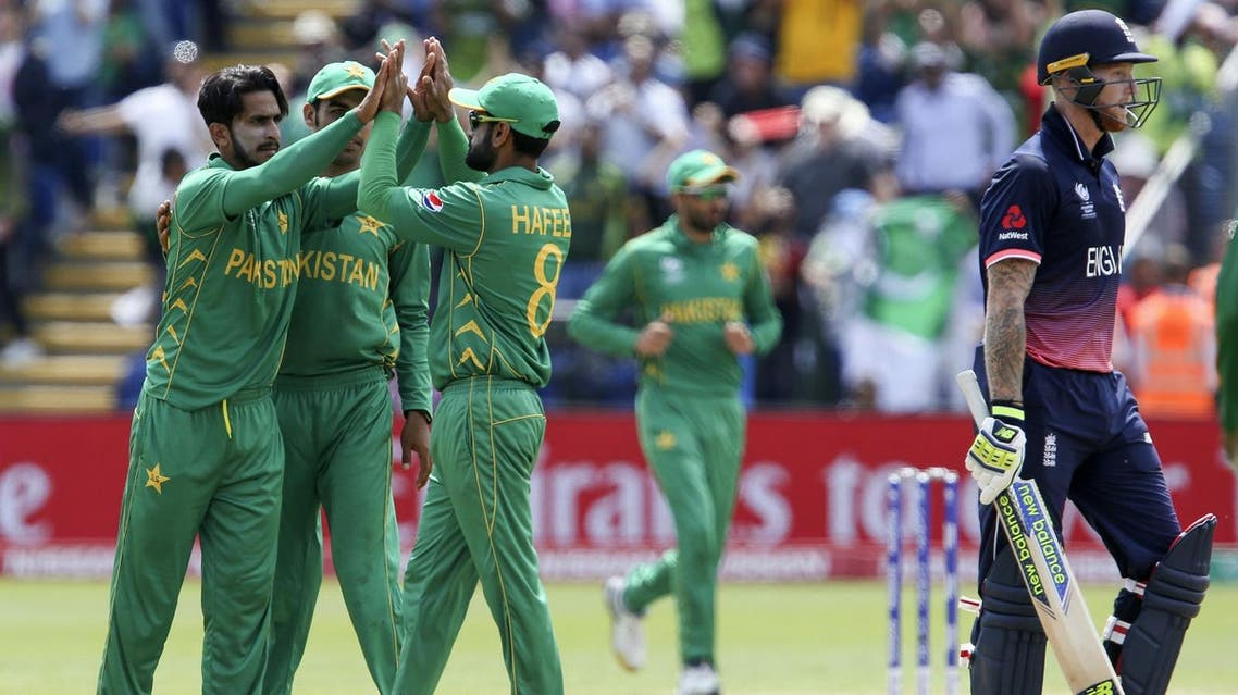 Pakistan's Mohammad Hafeez (C) celebrates with Pakistan's Hasan Ali (L)the wicket of England's Ben Stokes (R) for 34 during the ICC Champions Trophy semi-final cricket match between England and Pakistan in Cardiff on June 14, 2017. (AFP)
