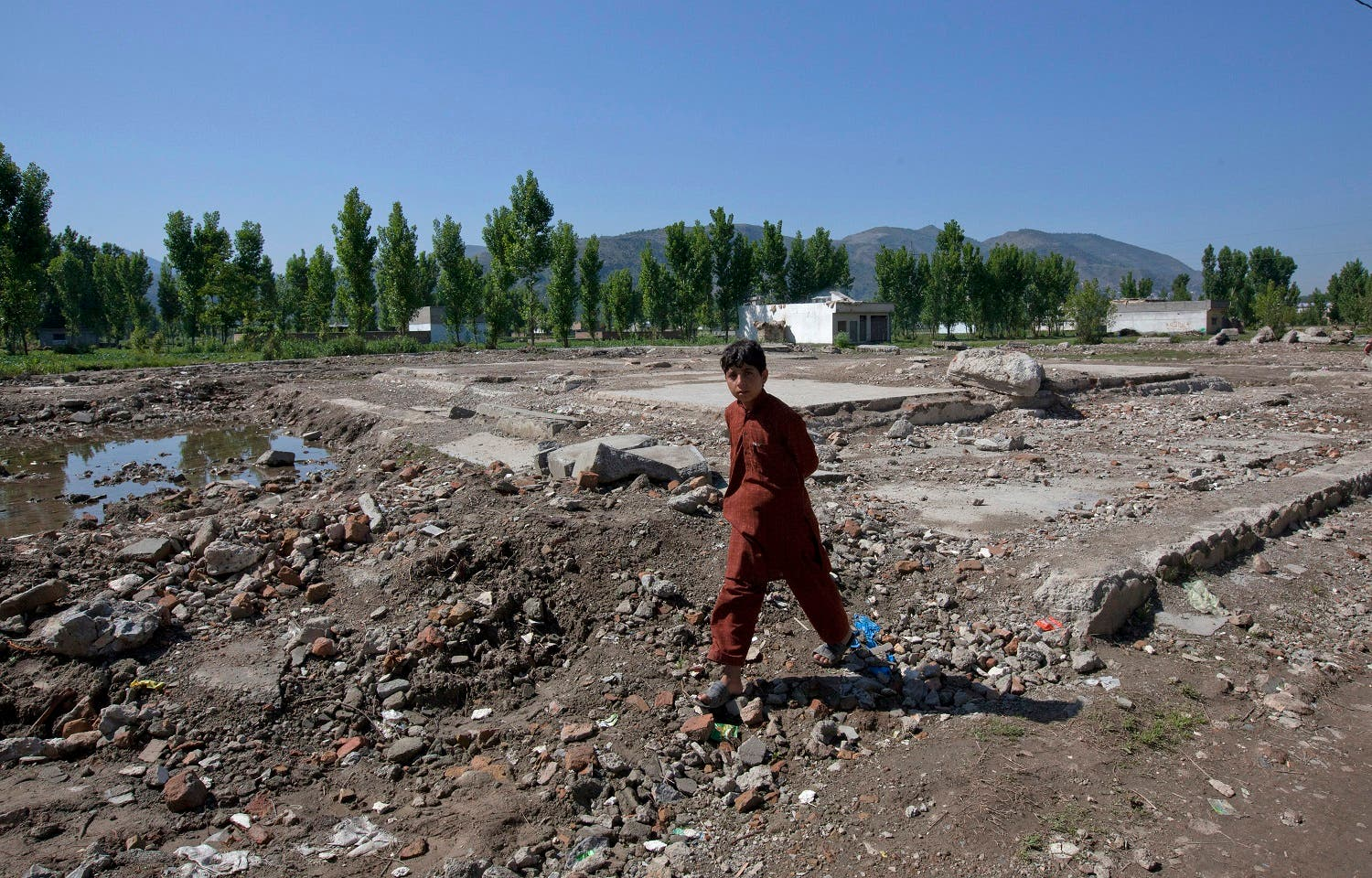 A boy walks past the demolished site of a compound of Osama bin Laden in Abbottabad May 2, 2012. (File photo: Reuters)