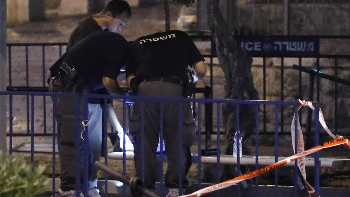 Israeli forensic police check the body of a suspected Palestinian assailant as another body lies on the foreground outside Damascus Gate in Jerusalem's Old City on June 16, 2017 following an attack. (AFP)