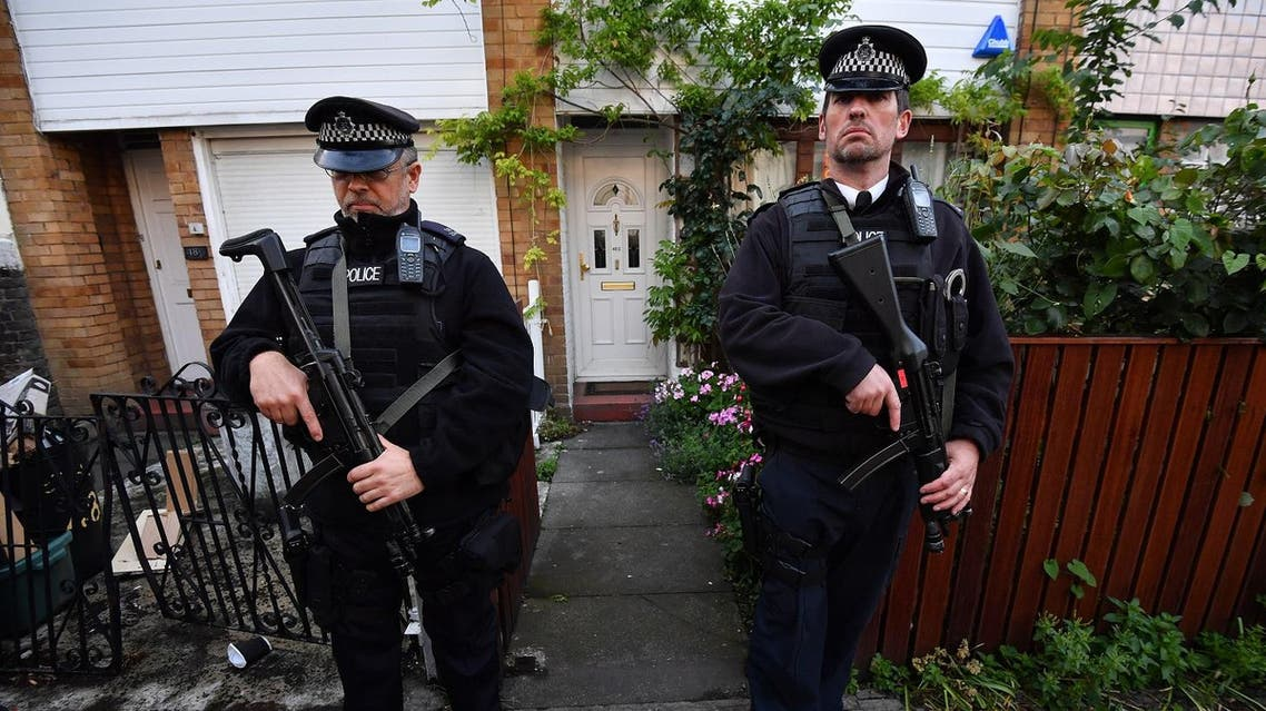 Armed police officers flank the entrance to the London home of Britain's opposition Labour party Leader Jeremy Corbyn on June 9, 2017. AFP
