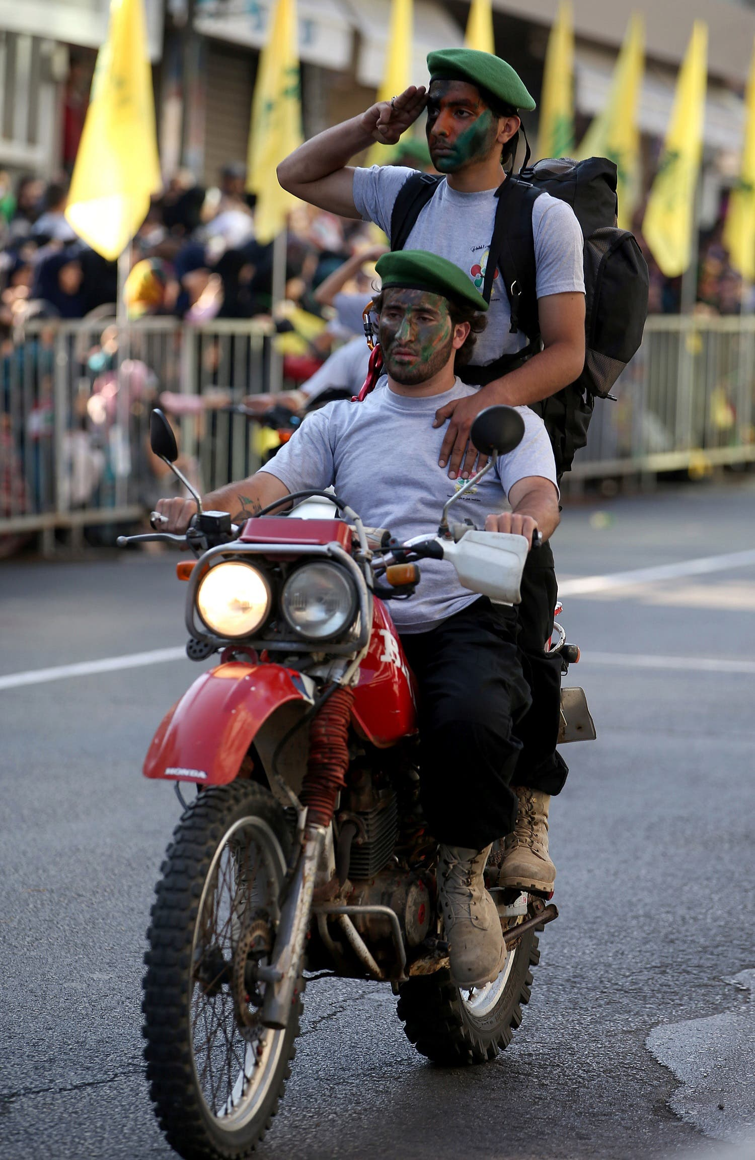 Hezbollah al-Mahdi scouts ride their motorcycle as they parade during an event for Jerusalem day or Al-Quds day, at the southern town of Nabatiyeh, Lebanon, Aug. 1, 2013. (AP)