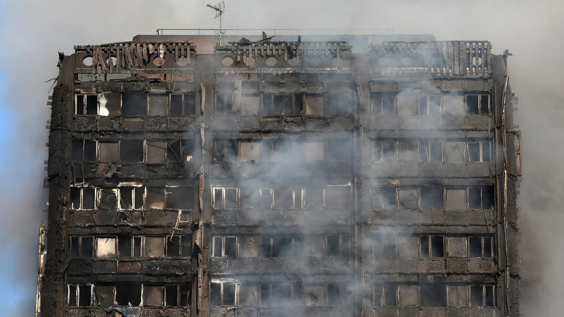 Smoke billows from a tower block severly damaged by a serious fire, in north Kensington, West London. (Reuters)