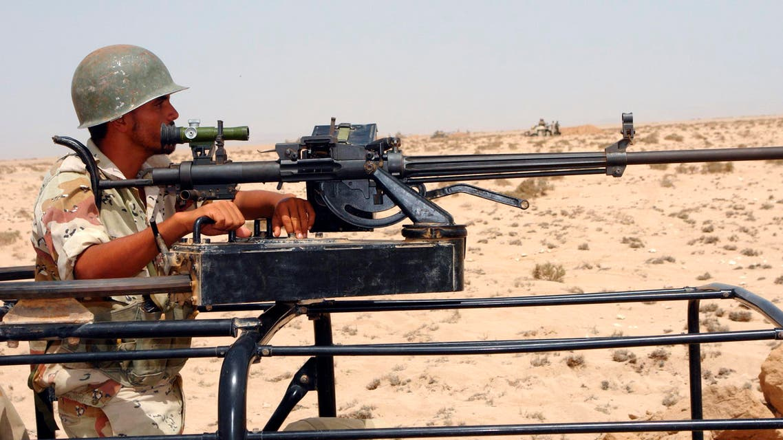 A Djiboutian soldier stands behind a heavy machine gun in an undisclosed location along the border with Eritrea, June 15, 2008. (AReuterS)