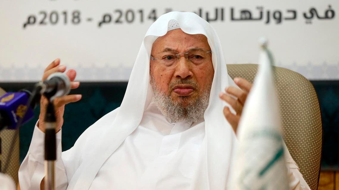 Chairman of the International Union of Muslim Scholars Yusuf al-Qaradawi (R) speaks during a news conference in Doha June 23, 2014. (Reuters)