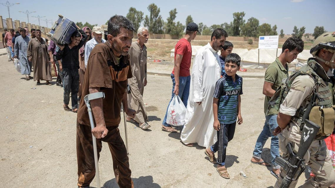 Displaced Iraqis gather at a temporary camp in the compound of the closed Nineveh International Hotel in Mosul on June 16, 2017 which was recovered by Iraqi troops from ISIS. (AFP)