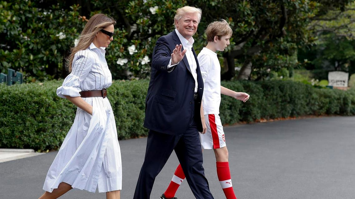 President Donald Trump, first lady Melania Trump, and their son and Barron Trump, walk to Marine One across the South Lawn of the White House in Washington, Saturday, June 17, 2017, en route to Camp David in Maryland. (AP)