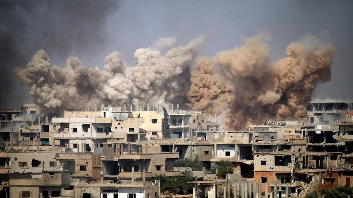 Smoke rises from buildings following a reported air strike on a rebel-held area in the southern Syrian city of Daraa, on June 14, 2017. (AFP)